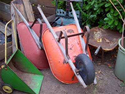 Actually five wheel barrows, if you count the handy little green weed barrow