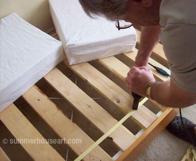 Will, stapling the slats made from pallets, summerhouseart.com