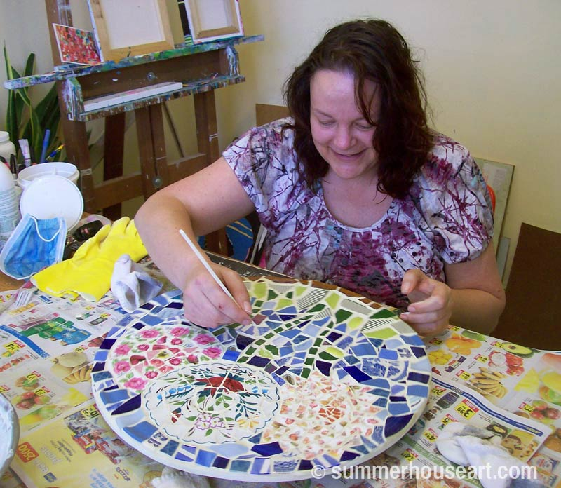 Student Jane, cleaning grout on her mosaic, summerhouseart.com