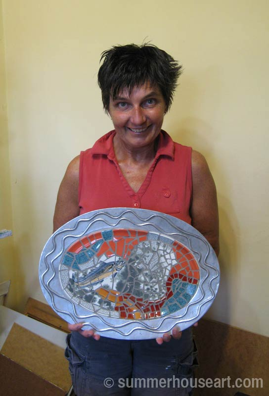 Mosaic Student Dianne with the finished mosaic dish, summerhouseart.com